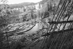 View of Duo Yi Shu Village through a bamboo gate - Yuanyang Rice Terraces. Yunnan, China Stock Photos