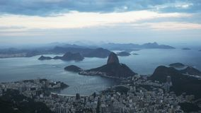 The view at dusk from corcavado towards Botafogo and Mt Sugarloaf in Rio