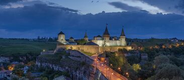 View at dusk on Kamianets-Podilskyi Castle. View of one of the most beautiful castles in Ukraine. The castle is illuminated at night in the town of Kamianets