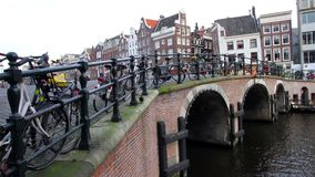 View of a Dutch canal and bridge in the center of Amsterdam stock video footage