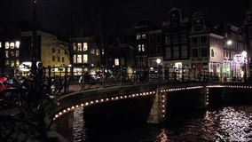 View of a Dutch canal and bridge in the Jordaan neighbourhood, Amsterdam stock video footage