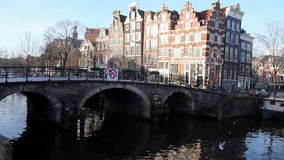 View of a Dutch canal and bridge in the Jordaan neighbourhood, Amsterdam stock video