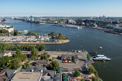 View Dutch harbor Amsterdam with marina, ferry and apartment buildings stock photo