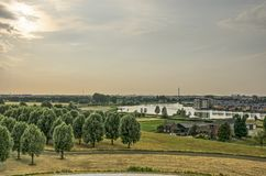 View from a Dutch mountain. View from an artificial hill towards the lake at the edge of suburb Carnisselanden near Rotterdam Stock Photos