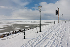 View from Dutch promenade at frozen sea. View from Dutch promenade of Urk at the frozen sea in wintertime stock photos