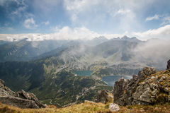 View from Eagle`s Path in Tatra Mountains to Five Polish Ponds Valley though the clouds Stock Image