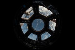 View of Earth through space shuttle windows Stock Photos