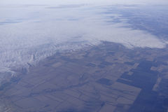 View of the Earth from under the wing of an aircraft Royalty Free Stock Photos