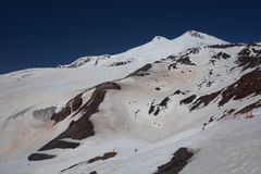 View of mountain Elbrus. Russia. View of the eastern and western peaks of Mount Elbrus Stock Photos