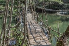 View of ecological bridge, made with recycled materials, in pedestrian route in the Dão river. In Alcafache, Portugal ecology wood wooden wild adventure royalty free stock image