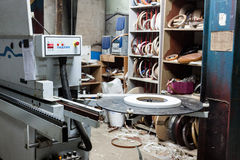 View on edge machine at carpenters workshop. Royalty Free Stock Images
