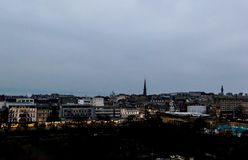 View of Edinburgh cityscape. Cityscape of Edinburgh at dusk with park and shopping street stock photo
