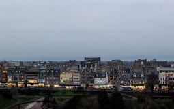 View of Edinburgh cityscape. Cityscape of Edinburgh at dusk with park and shopping street royalty free stock image