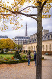 View of the Eiffel Tower for the autumn branches , located in front of the War Museum at Les Invalides in Paris esplanade . Stock Photography
