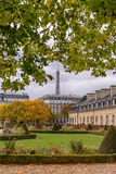 View Eiffel Tower for the autumn branches , located in front of the War Museum at Les Invalides in Paris esplanade . Royalty Free Stock Photography