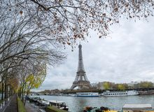 View of the Eiffel Tower from the river Seine embankment, Paris, France. Autumn. Rain. stock photo