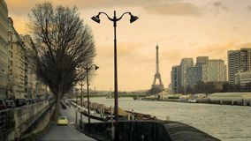View of the Eiffel Tower from a road on the Seine stock footage