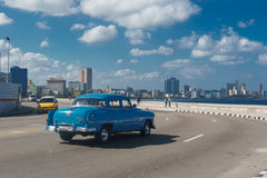 View from el Malecon with an old blue car, La Havana, Cuba. La Havana, Cuba December 25, 2016 view from el Malecon with an old blue car Royalty Free Stock Images