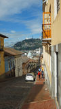 View of El Panecillo hill from Garcia Moreno street in the historic center of the city of Quito Stock Photos