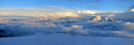 View from Elbrus in the clouds before the storm. View from Elbrus in the evening before the storm clouds Royalty Free Stock Photo