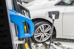 View of an Electric Car Charging and in the background a partial view of a car Royalty Free Stock Images