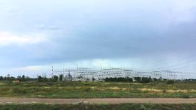 View of electric power plant from a window of the moving car. Europe, Poland. Summer 2018 stock video
