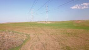 View of electricity towers at field.