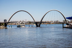 A view of Elizabeth Quay Bridge and ferry sailing underneath in Perth City Stock Photo