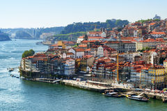 View of embankment of the Douro River and old houses in the hist Stock Image