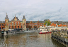 View of the embankment in front of the central station in Amsterdam Stock Photo