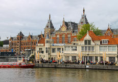 View of the embankment in front of the central station in Amsterdam Royalty Free Stock Photography