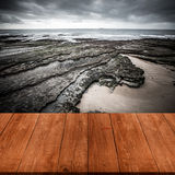 View of the embankment at low tide from dark wooden gangway or b Royalty Free Stock Photos