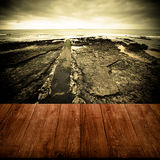 View of the embankment at low tide from dark wooden gangway or b Stock Photo