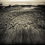 View of the embankment at low tide from dark wooden gangway or b Royalty Free Stock Images
