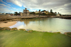 View of the embankment at low tide. Estoril, Lisbon, Portugal Royalty Free Stock Photography