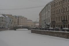 View of the embankment of Moyka river the historical center of Saint-Petersburg, Russia. Winter time with snow and ice royalty free stock photos