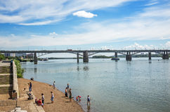 View of the embankment of the Ob river, resting people, and the. The river Ob, Novosibirsk, Siberia, Russia - July 17, 2017 October  Utilities  bridge campers Royalty Free Stock Image