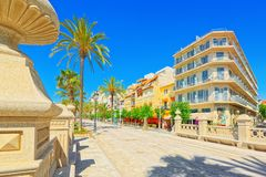 View of the embankment and the promenade in small resort town-Si. Sitges, Spain - June 14, 2017 : View of the embankment and the promenade in small resort town Royalty Free Stock Photo