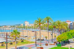 View of the embankment and the promenade in small resort town-Si. Sitges, Spain - June 14, 2017 : View of the embankment and the promenade in small resort town Royalty Free Stock Photography