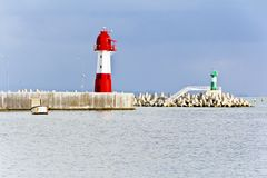 View from embankment to lighthouse Stock Image