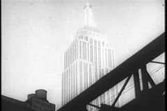 View of Empire State Building from below elevated train stock video
