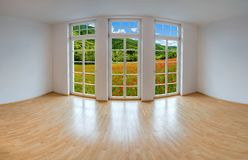 View from an empty apartment to a romantic landscape stock image