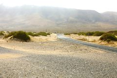 View of empty asphalt road in desert of Lanzarote, Canary Islands Royalty Free Stock Photos