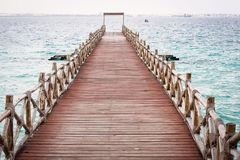 View of an empty bridge  over water. View of an empty bridge over water with clear sky Royalty Free Stock Images