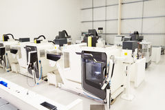 View Of Empty Engineering Workshop With CNC Machines Stock Photos