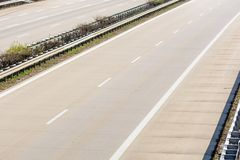 Empty two-lane highway with crash barriers. View of an empty highway with crash barriers stock images