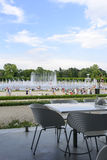 The view from the empty restaurant on people cooling using public fountains in the hottest day on 19 July 2015 in Wroclaw, Poland. Stock Photos