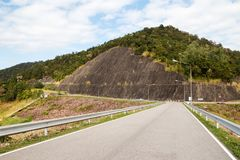 View on the empty road in the mountains near to dam. royalty free stock photography