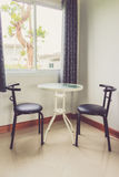 View of empty room with wooden table and chair Royalty Free Stock Photos