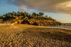 View on Empty Sandy Beach with Hill and Palms Stock Images